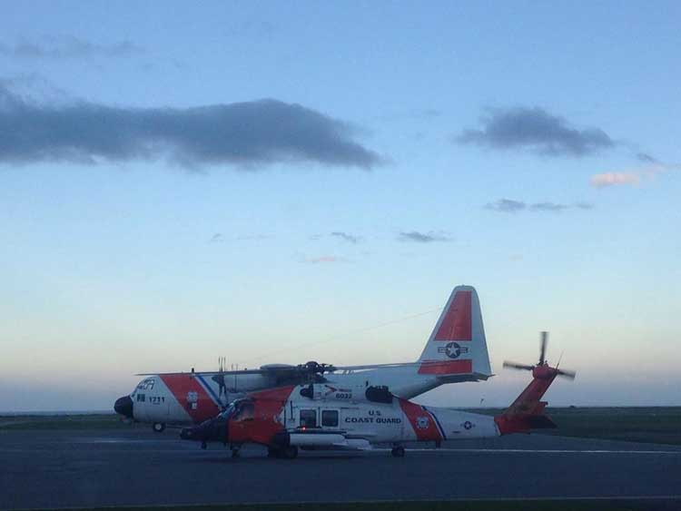 US Coast Guard C-130 Hercules and Skyhawk helicopter on standby at Sandspit airport.  The Hercules carried  one of Alaska's Emergency Towing Systems in case it was needed.  (US Coast Guard)