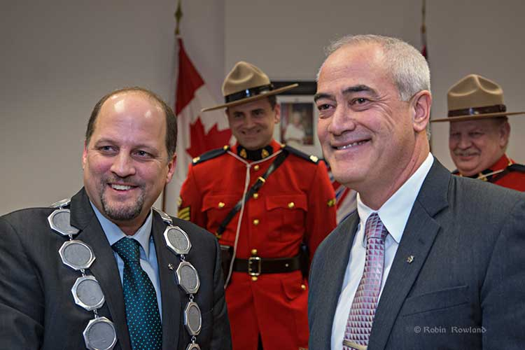 Kitimat's new mayor, Phil Germuth (left) sworn in by Chief Administrative Officer Ron Poole (far right) as RCMP Sgt. Graham Morgan and Staff Sergeant Phil Harrison watch. (Robin Rowland/Northwest Coast Energy News)
