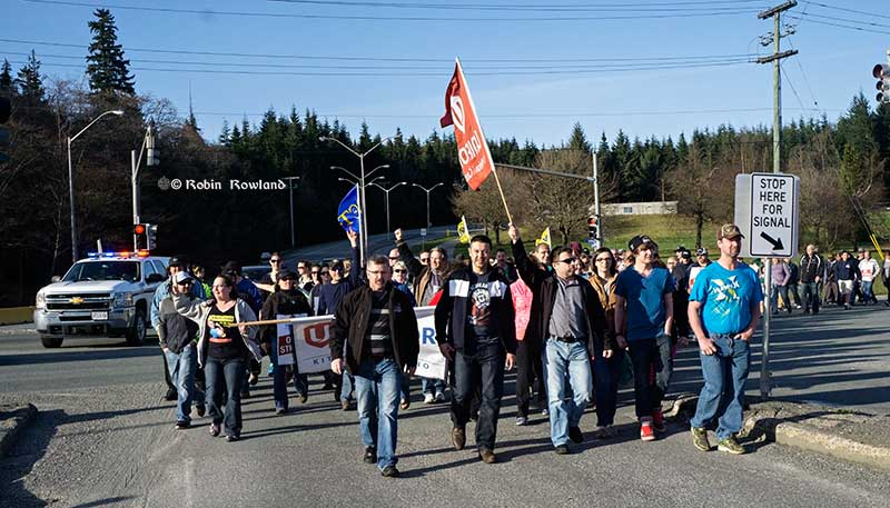 Members of Unifor 2300 march to the District of Kitimat Council Chambers on April 7, 2015. (Robin Rowland/Northwest Coast Energy News)