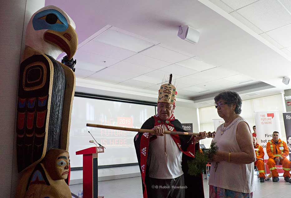 Sammy and Rose Robinson bless the new totem pole at Henning Hall. (Robin Rowland/Northwest Coast Energy News)