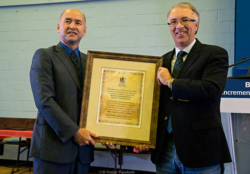 BC Minister of Aboriginal Relations and Reconciliation John Rustad presented Chief Counsellor Ellis Ross with a certificate commemorating the incremental treaty agreement (Robin Rowland/Northwest Coast Energy News)