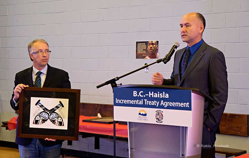 Chief Counsellor Ellis Ross presented BC Minister of Aboriginal Relations and Reconciliation John Rustad with a painting of two paddles, representing how people have to work together to accomplish goals. (Robin Rowland/Northwest Coast Energy News)