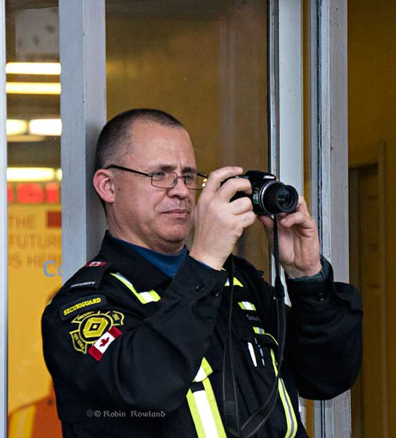 A Plant Protection security guard recorded and photographed the rally in front of the Rio Tinto City Centre office. (Robin Rowland/Northwest Coast Energy News)