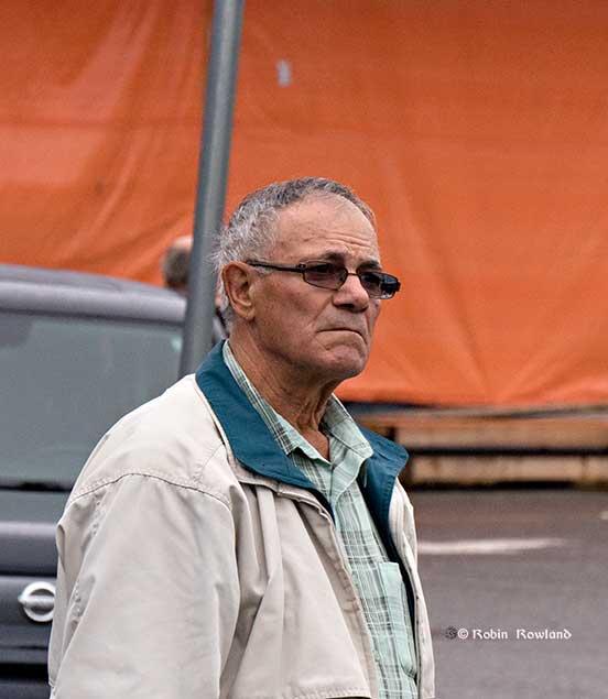 A spectator watches the rally. (Robin Rowland/Northwest Coast Energy News)